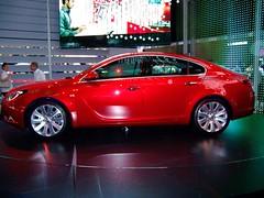 sports car(0.0), automobile(1.0), executive car(1.0), wheel(1.0), vehicle(1.0), automotive design(1.0), full-size car(1.0), mid-size car(1.0), opel insignia(1.0), compact car(1.0), sedan(1.0), land vehicle(1.0), luxury vehicle(1.0),