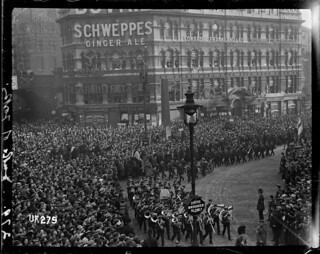 An armed forces band and soldiers marching in London at the end of World War I, 1918