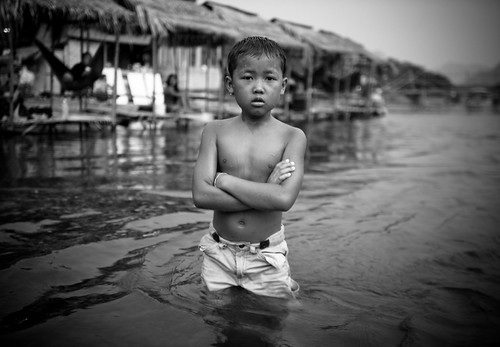 Laos boy in the river