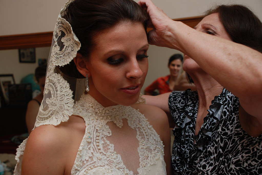 Mom pinning the veil in