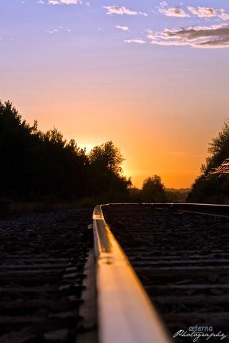railroad sunset train tracks rails distance vanish