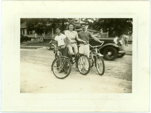 Three with bicycles