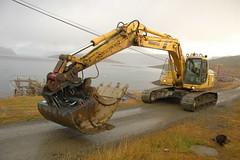sand(0.0), demolition(0.0), crane(0.0), vehicle(1.0), construction equipment(1.0), bulldozer(1.0), land vehicle(1.0),