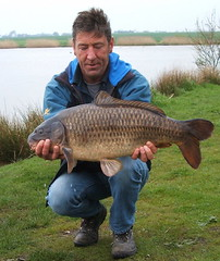 Pete with a  22lb Common Carp caught from Moss Lake on halibut pellet. Biggest so far of 2008.