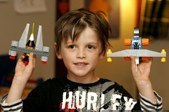 two of about ten lego fighter ships laying around th…