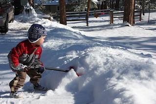 Austin shoveling snow.