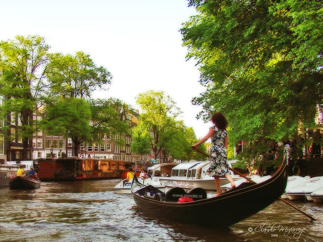 Amsterdam, Holland 078 - A lady driving a gondola