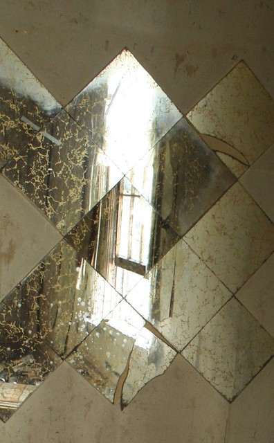 Fractured Window In The Gold Veined Mirror Tiles Img