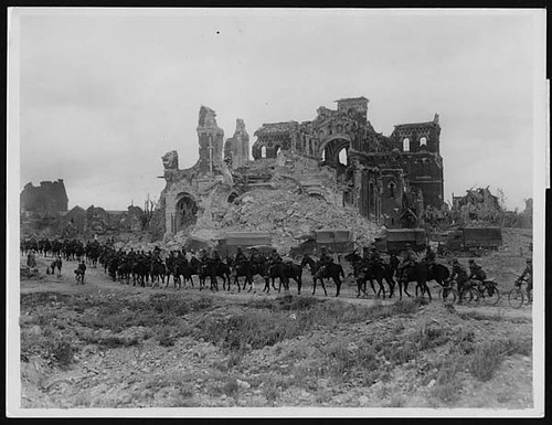British cavalry passing the ruins of Albert cathedral, France, during World War I