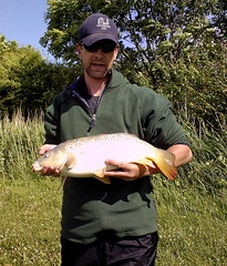 Chris with an 8lb Common from Island Pool caught on feeder tactics using 2 hair rigged pellets - 19th June 08.