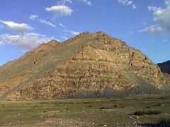 prairie(0.0), valley(0.0), mound(0.0), plateau(0.0), monument(0.0), wadi(0.0), butte(0.0), steppe(1.0), mountain(1.0), spoil tip(1.0), plain(1.0), hill(1.0), geology(1.0), ridge(1.0), fell(1.0), landscape(1.0), badlands(1.0), grassland(1.0), mountainous landforms(1.0),