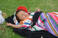 DSC02119 Sleeping in the park while his mother sells sundries nearby