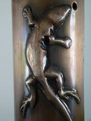 carving(0.0), relief(0.0), monument(0.0), statue(0.0), art(1.0), sculpture(1.0), metal(1.0), bronze(1.0), bronze sculpture(1.0), bronze(1.0),