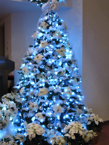 """Snowed In"" 9 ft tree with White Poinsettias & LED Lights"