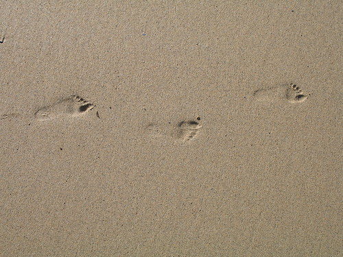 Child's footprints in the sand | by andybullock77