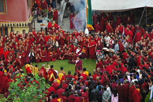 26 photographers and videographers capturing HH Dagchen Sakya with Sons and Grandsons, Rededicating and Blessing Prayer Flags at Tharlam Monastery, table of offerings, encircled by a crowd, with clouds of incense, Boudha, Kathmandu, Nepal by Wonderlane