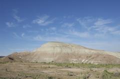 spoil tip(0.0), sea(0.0), ridge(0.0), monument(0.0), butte(0.0), prairie(1.0), steppe(1.0), horizon(1.0), cloud(1.0), soil(1.0), mountain(1.0), sand(1.0), valley(1.0), mound(1.0), plain(1.0), hill(1.0), geology(1.0), natural environment(1.0), plateau(1.0), fell(1.0), landscape(1.0), badlands(1.0), rock(1.0), grassland(1.0), sky(1.0), mountainous landforms(1.0),