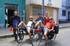 Group pose at Casa de ciclistas as Pius and Stefan leave