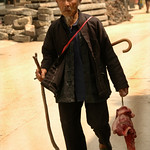 Man Carrying Meat to Market - Guizhou Province, China