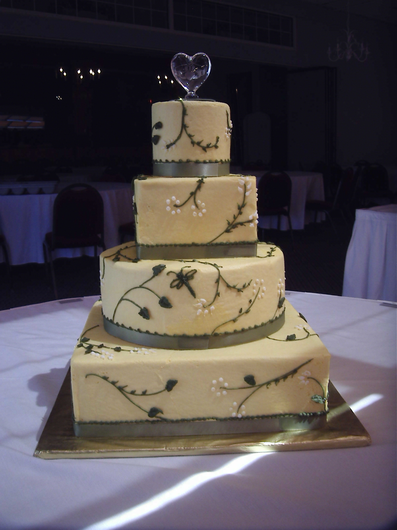 Wedding cake in round and square yellow buttercream