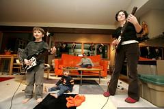 nick and rachel introduce paula to guitar hero    MG…