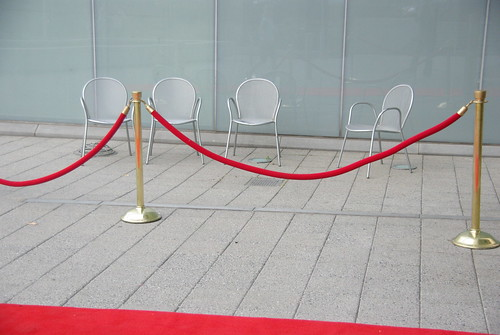 Red carpet? Velvet Rope? Keeps the chairs away...