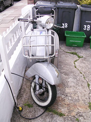 cruiser(0.0), scooter(1.0), wheel(1.0), vehicle(1.0), motorcycle(1.0), vespa(1.0),