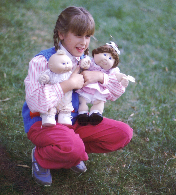 1980s (mid) - Eve - holding Cabbage Patch Kids dolls - kneeling - 0025