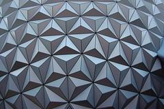 floor(0.0), mosaic(0.0), brown(0.0), tile(0.0), circle(0.0), monochrome(0.0), flooring(0.0), art(1.0), pattern(1.0), symmetry(1.0), triangle(1.0), line(1.0), design(1.0), wallpaper(1.0), black(1.0),