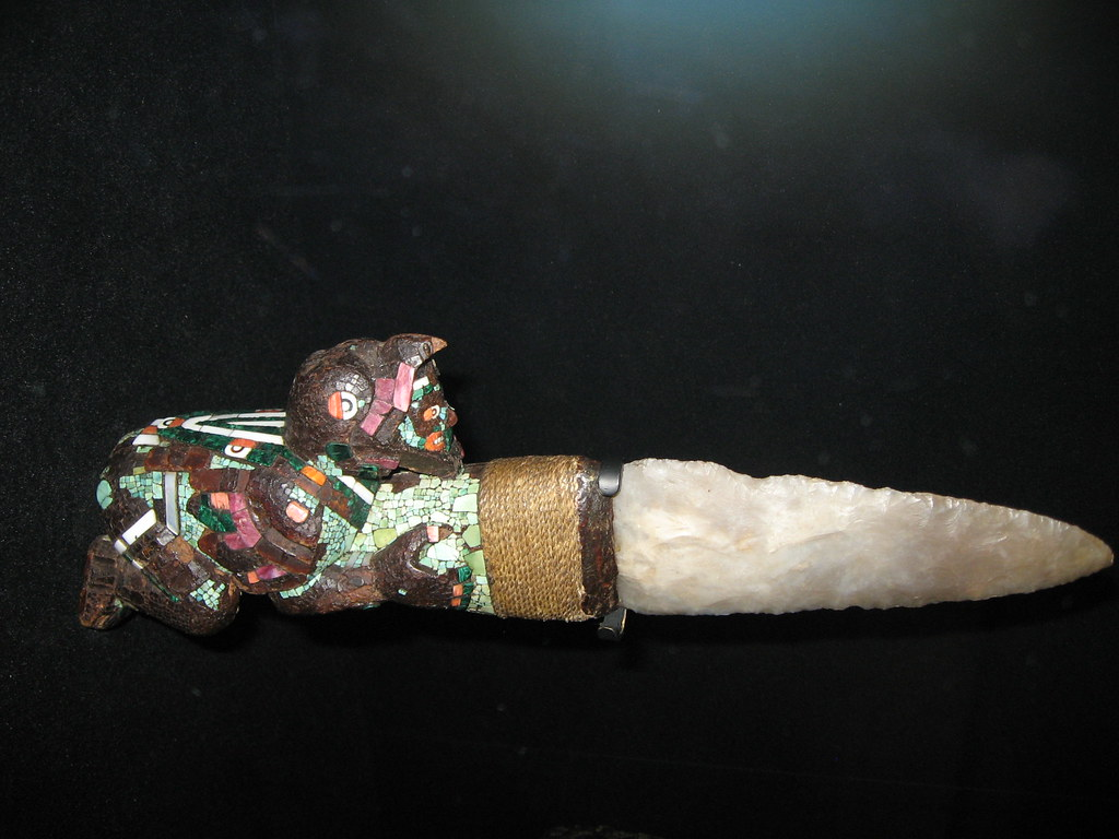 aztec or mixtec ceremonial knife An aztec ceremonial knife with a cedarwood handle and flint blade the figure of the handle is covered in turquoise and shell mosiac and represents an aztec eagle knight 1400-1521 ce.