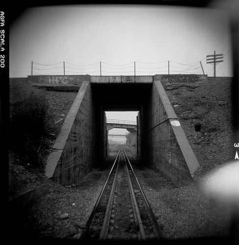 eyetwist holga holgaography toycamera scansfromthearchives plasticcamera 120 mediumformat lores plasticfantastic toycameracom vignette square ishootfilm sacramento bw norcal sacto rairoad tracks vanishingpoint unionpacific viaduct bridge rail railroad agfa scala transparency contrast ishootagfa california blackwhite monochrome film emulsion analog analogue northern eyetwistkevinballuff 120s vanishing point black white light leak epsonv750pro filmtagger 200 200x rescan tunnel train concrete wp westernpacific toy camera plastic lightleak