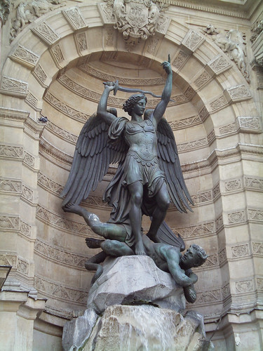 Statue of the Archangel Micheal defeating Satan