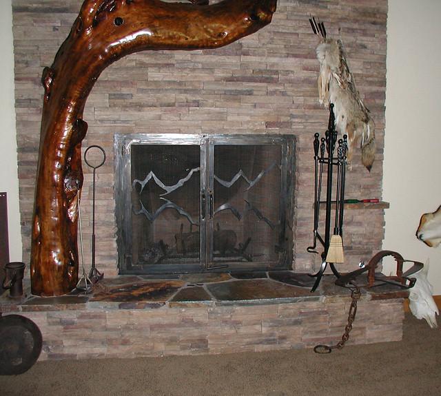 custom fireplace doors with decorative mountain
