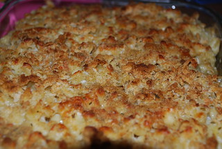 A close-up view of a dish of golden brown baked macaroni and cheese