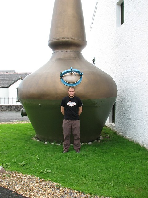 Neil standing in front of the still at Ardbeg