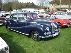 mid-size car(0.0), dkw 3=6(0.0), automobile(1.0), vehicle(1.0), bmw 501(1.0), compact car(1.0), antique car(1.0), sedan(1.0), classic car(1.0), vintage car(1.0), land vehicle(1.0), luxury vehicle(1.0),