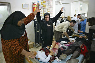 Victims treated in a recent bombing in Kirkuk, Iraq. Despite false corporate media claims in the United States, the war continues with many dying daily inside the country. by Pan-African News Wire File Photos