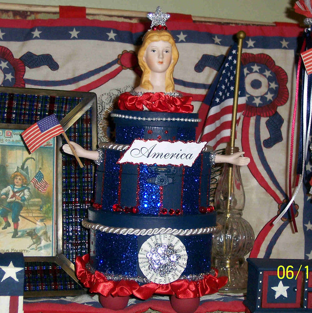An AllAmerican wedding cake of sorts Three navy blue boxes are connected