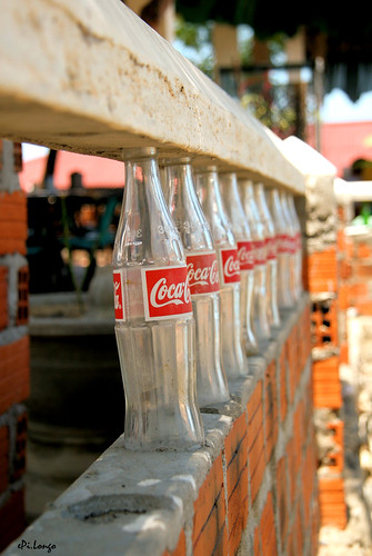 Fence built up with Coke's bottles