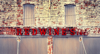 REDWINE'S INC. sign in old train stop town OK oklahoma