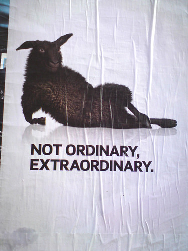 poster in the city of Amsterdam: NOT ORDINARY. EXTRAORDINARY.