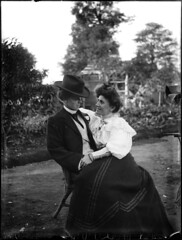 Young couple seated in garden