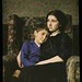 Woman and boy sitting in chair by George Eastman House
