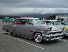 automobile(1.0), automotive exterior(1.0), vehicle(1.0), mercury montclair(1.0), sedan(1.0), classic car(1.0), land vehicle(1.0), luxury vehicle(1.0), convertible(1.0),