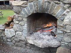 kitchen appliance(0.0), iron(0.0), stone wall(1.0), wall(1.0), masonry oven(1.0), wood(1.0), fireplace(1.0), rock(1.0), hearth(1.0),