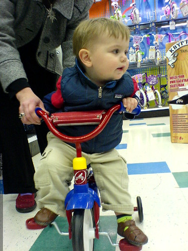 sequoia, pedaling around toys r us on a trike   DSC00505