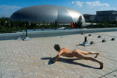 beijing-nude-olympics. Guangdong TV news presenter Ou Zhihang performing ...
