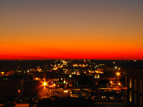 city red sky orange against clouds lights downtown glare streetlights horizon gradient skyward greeneyephoto
