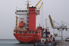 crane vessel (floating)(0.0), research vessel(0.0), bulk carrier(0.0), jackup rig(0.0), anchor handling tug supply vessel(0.0), platform supply vessel(0.0), fishing vessel(0.0), offshore drilling(0.0), semi-submersible(0.0), container ship(0.0), port(1.0), vehicle(1.0), freight transport(1.0), ship(1.0), construction equipment(1.0), watercraft(1.0), tugboat(1.0),