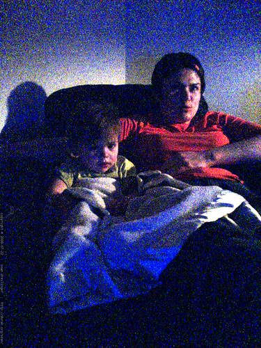 rachel tries to enjoy finding nemo while sequoia fiddles with the electric home theatre recliner   DSC01682